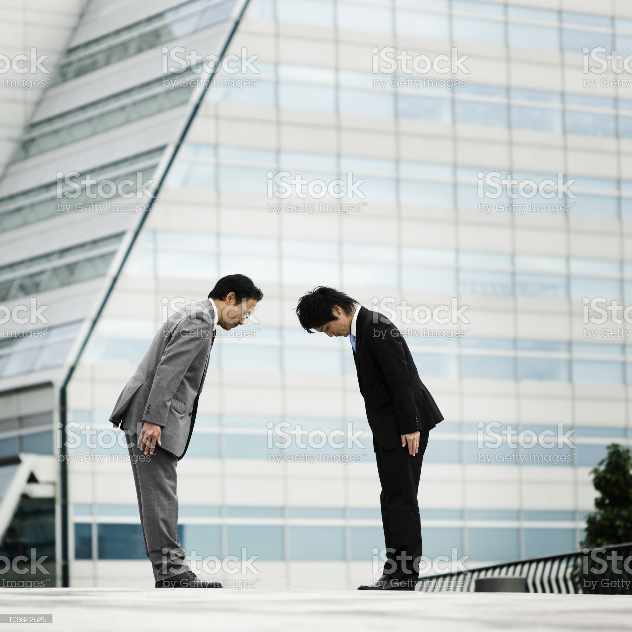 Two Asian Businessmen Bowing royalty-free stock photo
