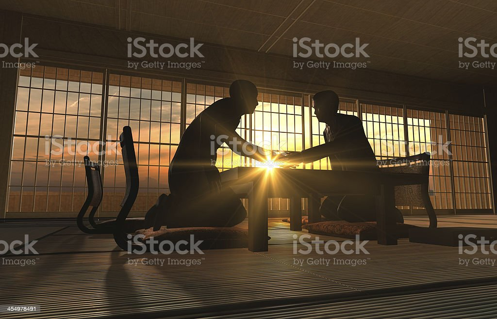 Two Asian Businessmen handshake in meeting room royalty-free stock photo