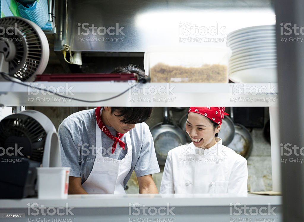 Two Asian Chefs Working in the Kitchen stock photo