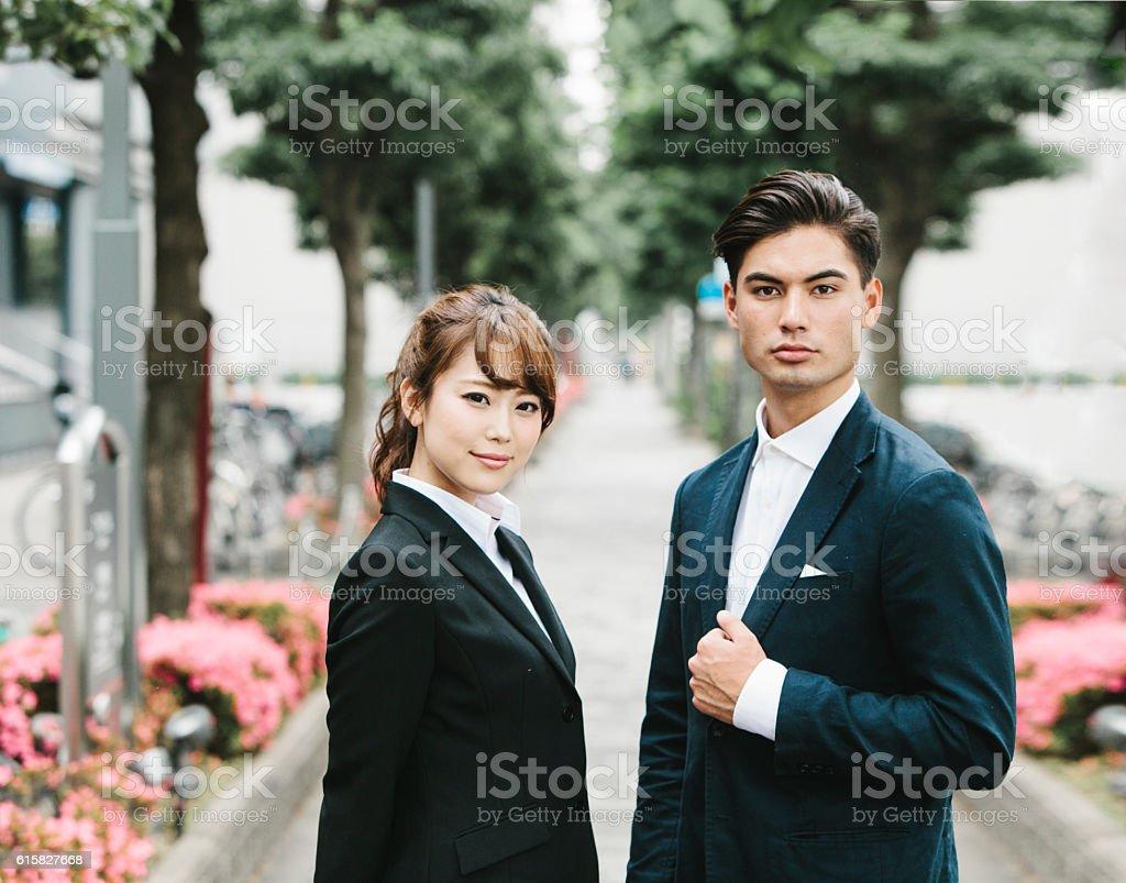 Two Asian Entrepreneurs on the Street stock photo