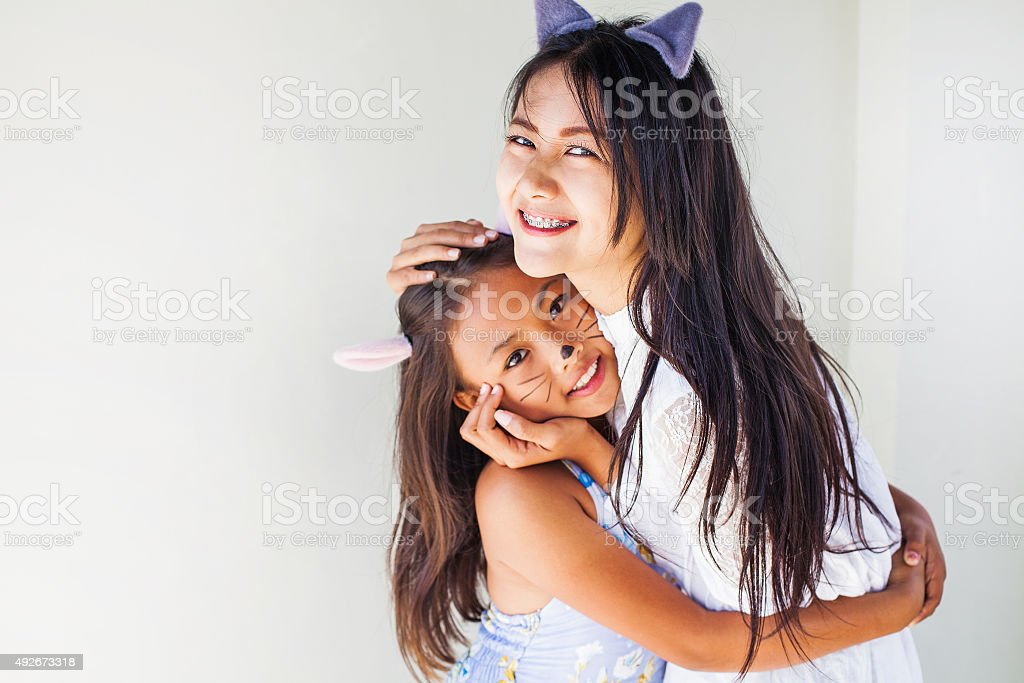 two asian girls dressed wearing cat ears stock photo