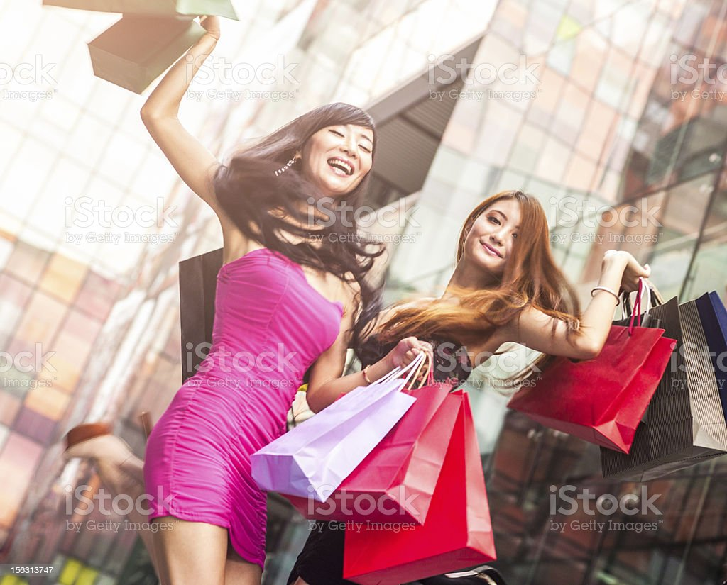 Two asian girls shopping stock photo