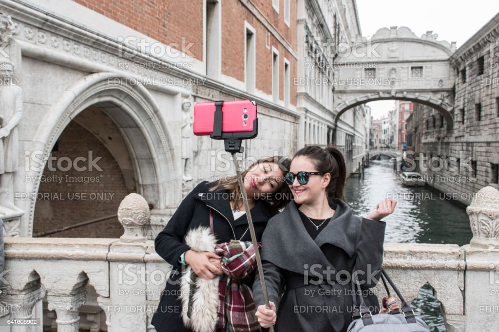 Two Asian girls take selfie at Bridge of Sighs, Venice. stock photo