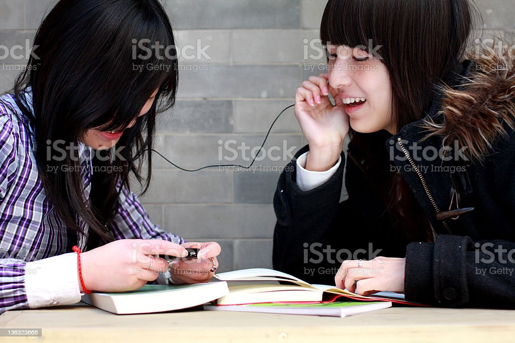 two asian students listen music royalty-free stock photo