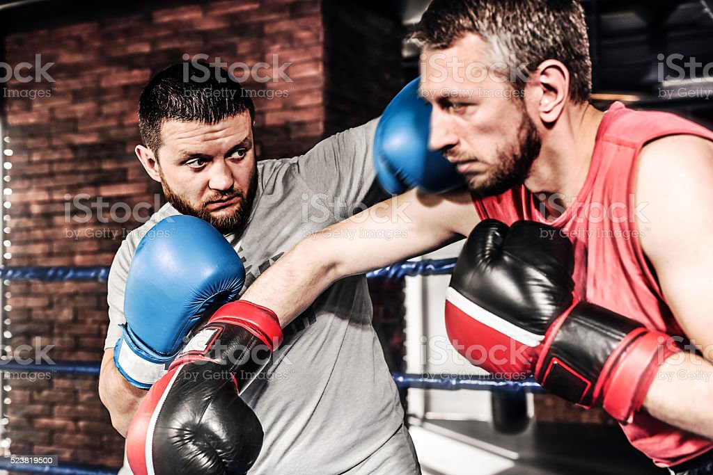Two athletes boxers sparred in the ring stock photo