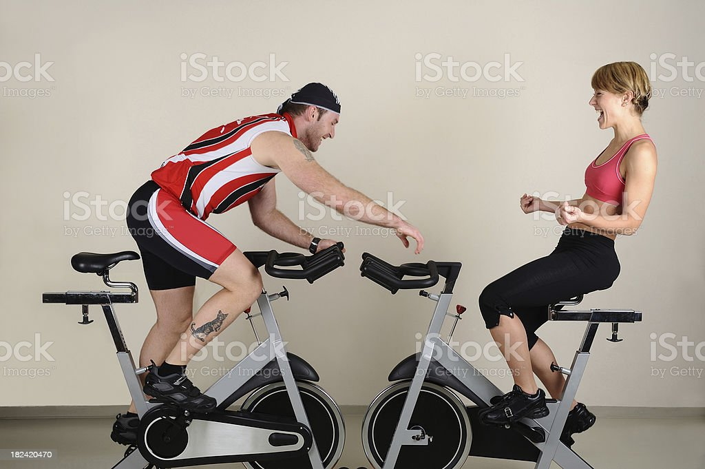 Two athletes having fun during spinning exercise royalty-free stock photo