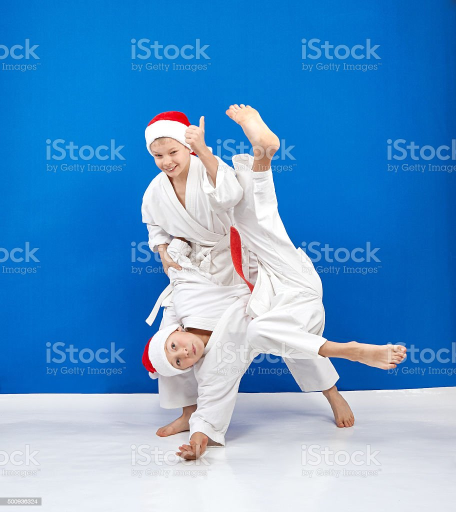 Two athletes in caps of Santa Claus are training throws stock photo