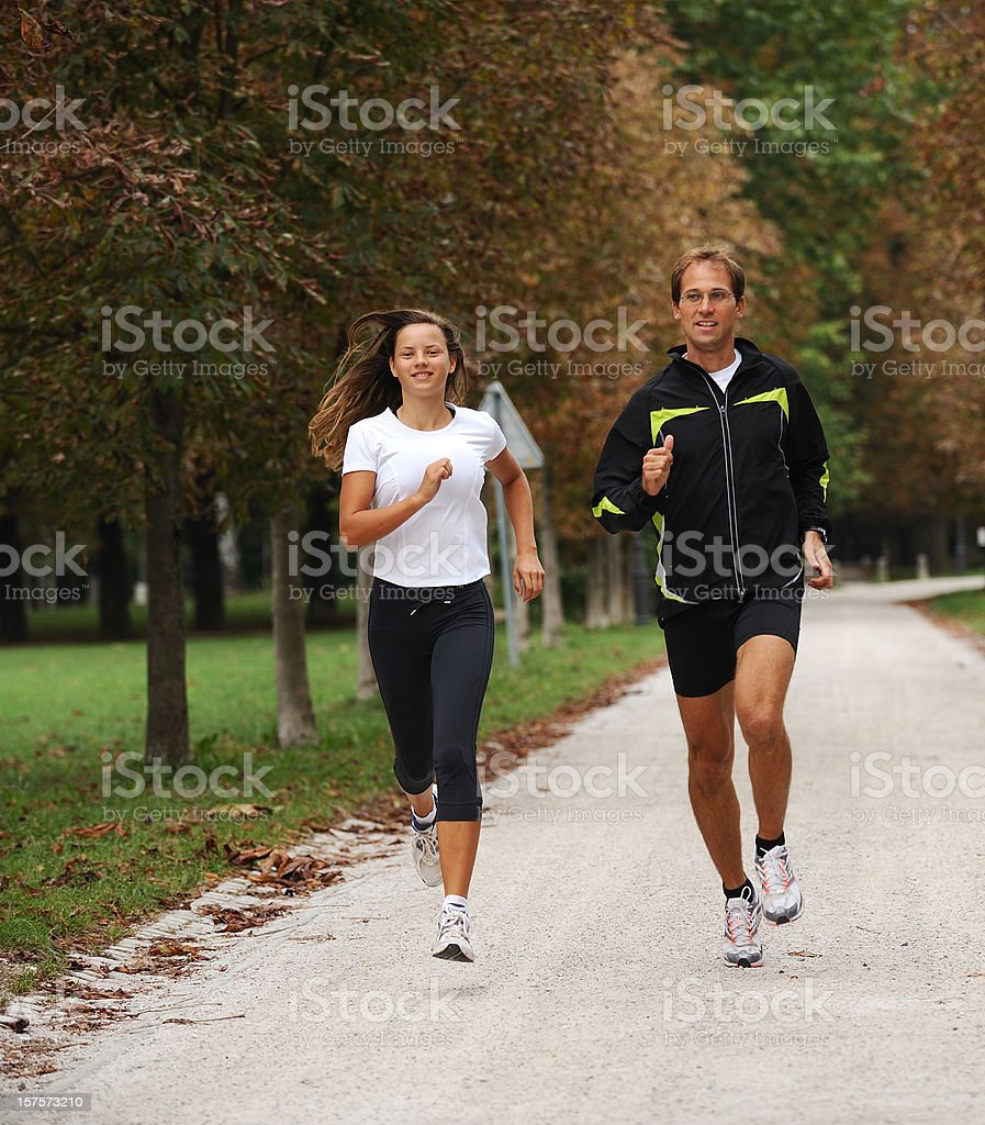 Two athletes jogging stock photo