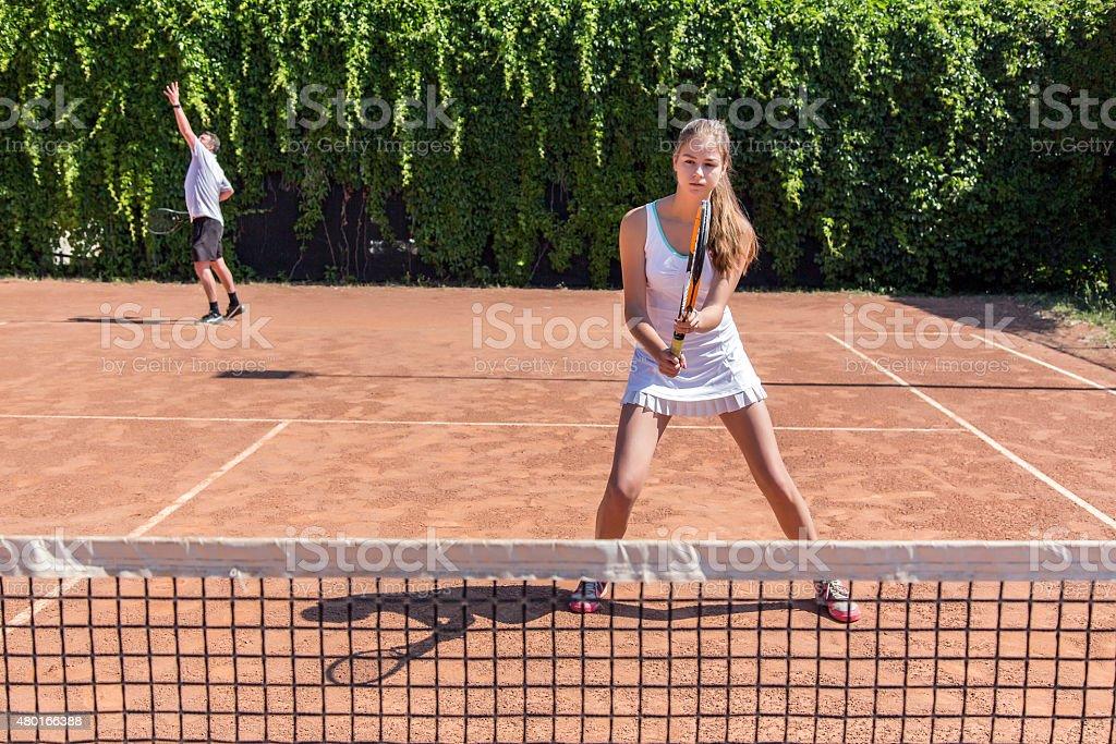 Two athletes on tennis court stock photo
