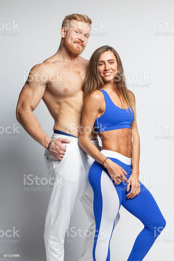 two athletic young people - man and woman stock photo