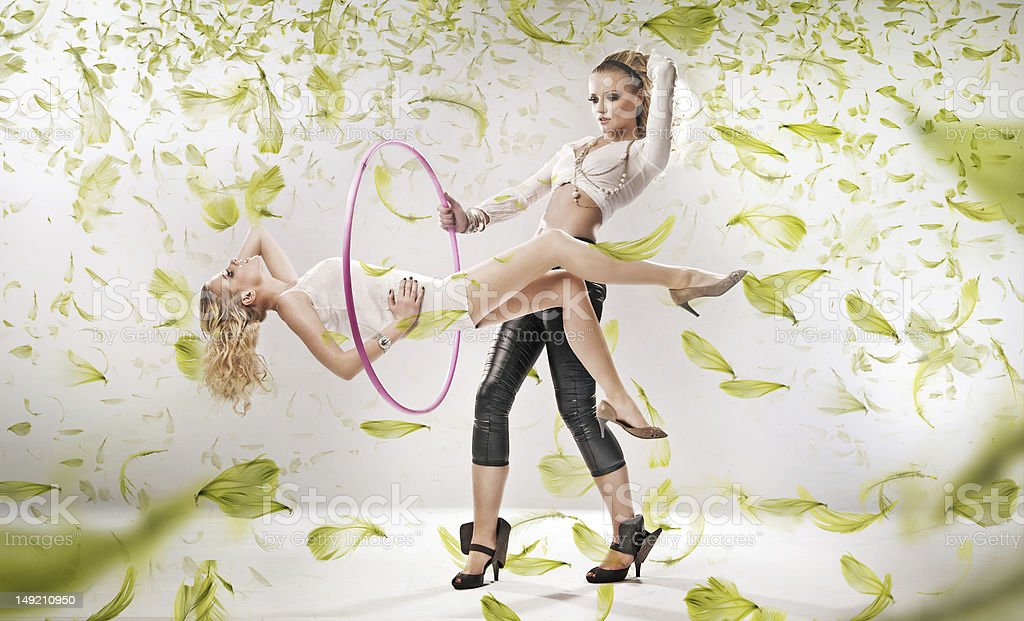 Two attractive girls exercise fitness royalty-free stock photo