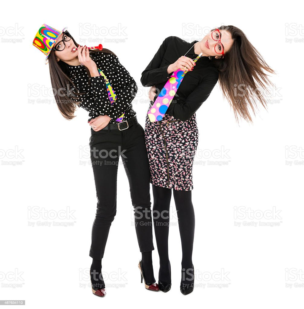 Two Attractive Girls having Party and Celebrating Birthday or Holiday stock photo