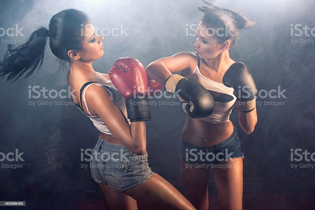 Two attractive girls sparring stock photo