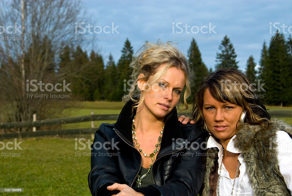 Two attractive women in a solid friendship royalty-free stock photo