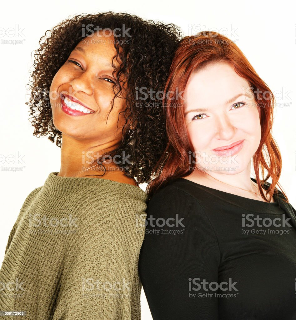 Two attractive women over white background stock photo