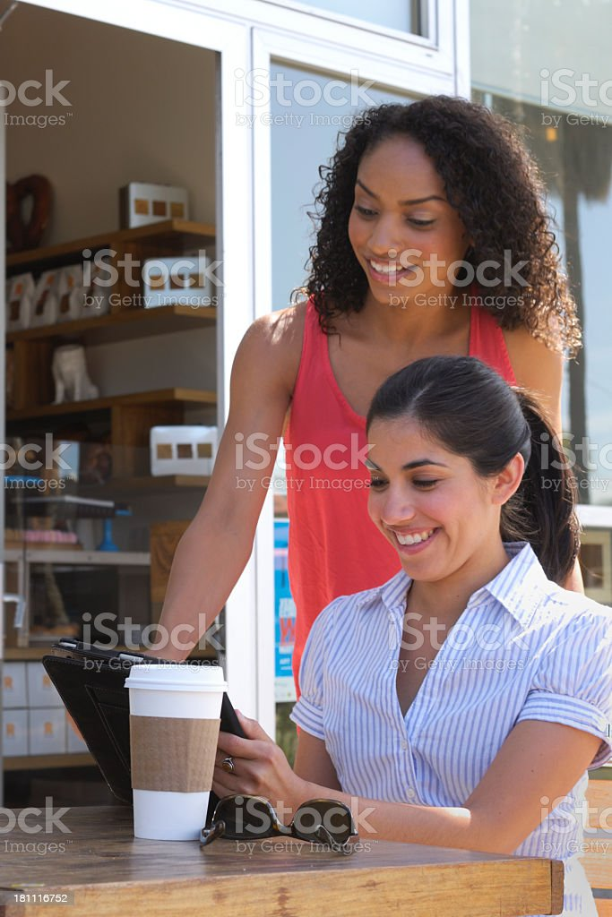 Two Attractive Young Women at Cafe Table royalty-free stock photo