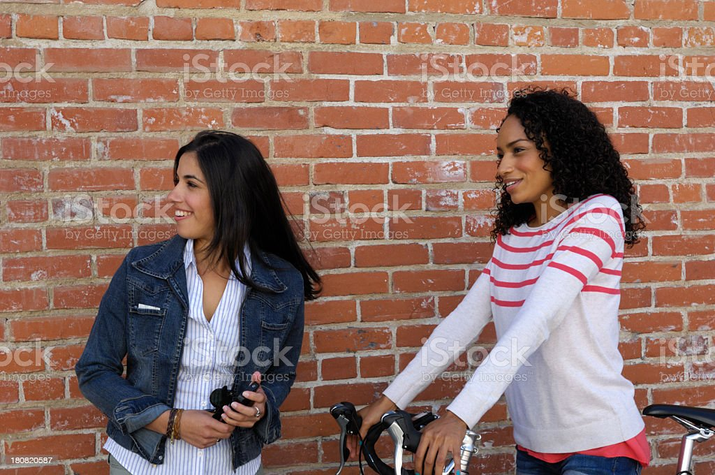 Two Attractive Young Women Looking Off to the Side royalty-free stock photo