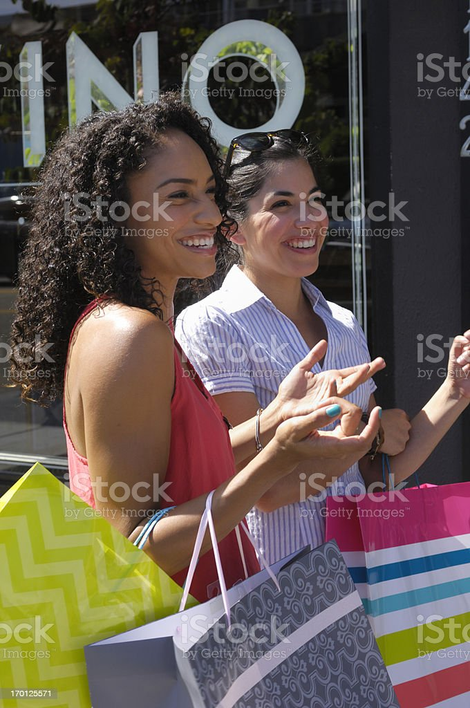 Two Attractive Young Women with Shopping Bags royalty-free stock photo
