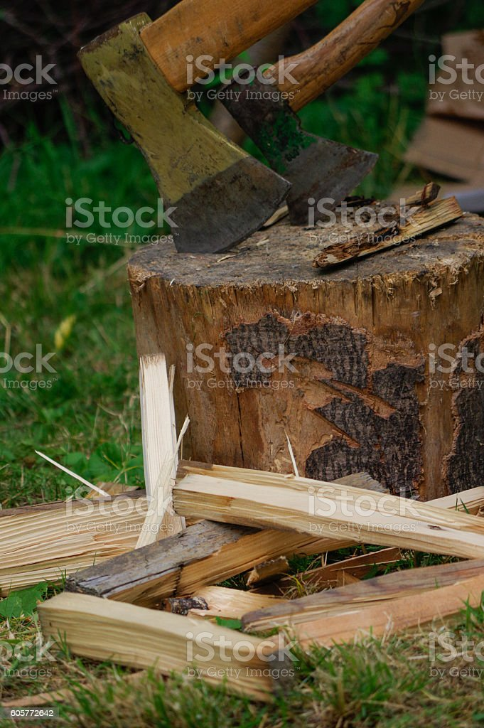 two ax in stump with wood crest on a background stock photo