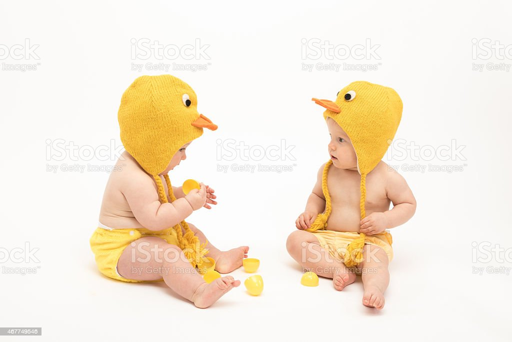 Two babies in duck costumes stock photo