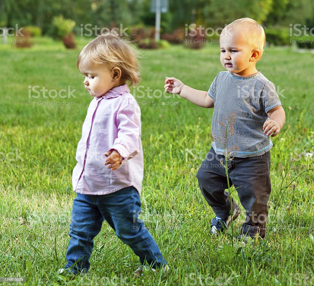 Two babies in park royalty-free stock photo