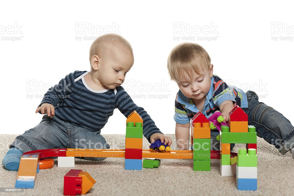 Two baby boys are playing royalty-free stock photo
