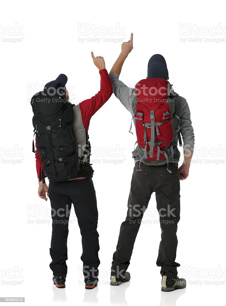 Two backpackers pointing up royalty-free stock photo