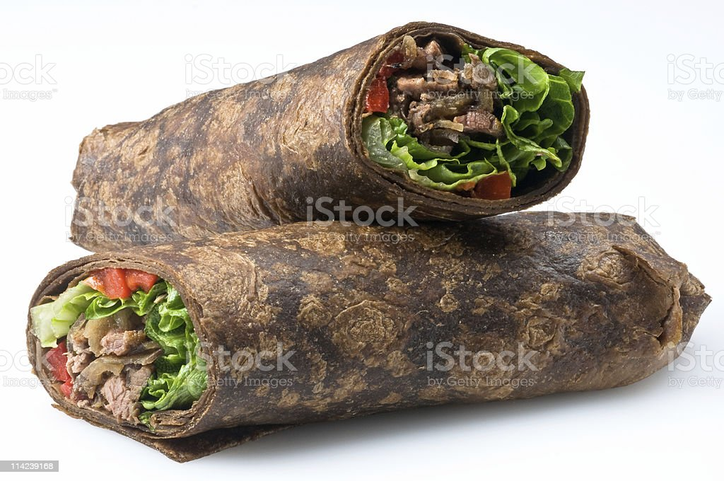 Two baked filled steak fajita wrap with lettuce and tomato. royalty-free stock photo