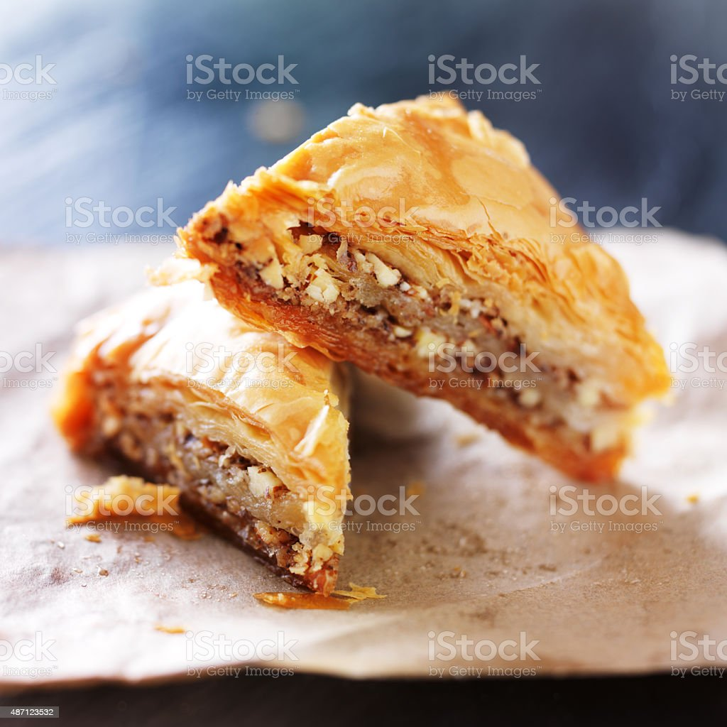 two baklava halves sitting on wax paper stock photo