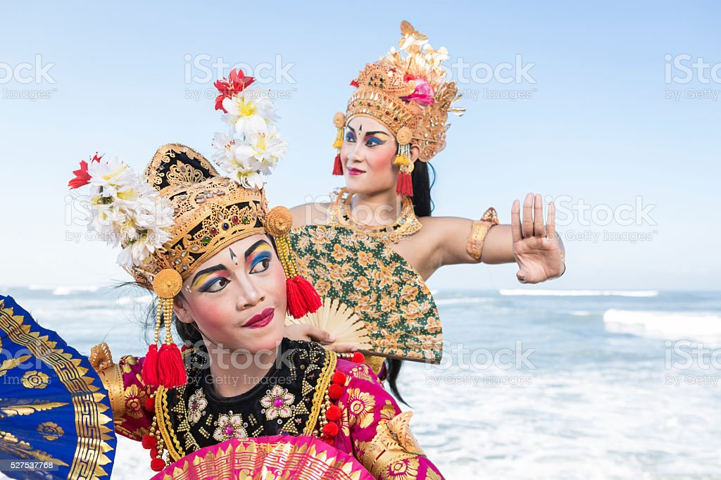 Two Bali female dancers in traditional costume performing with fans stock photo