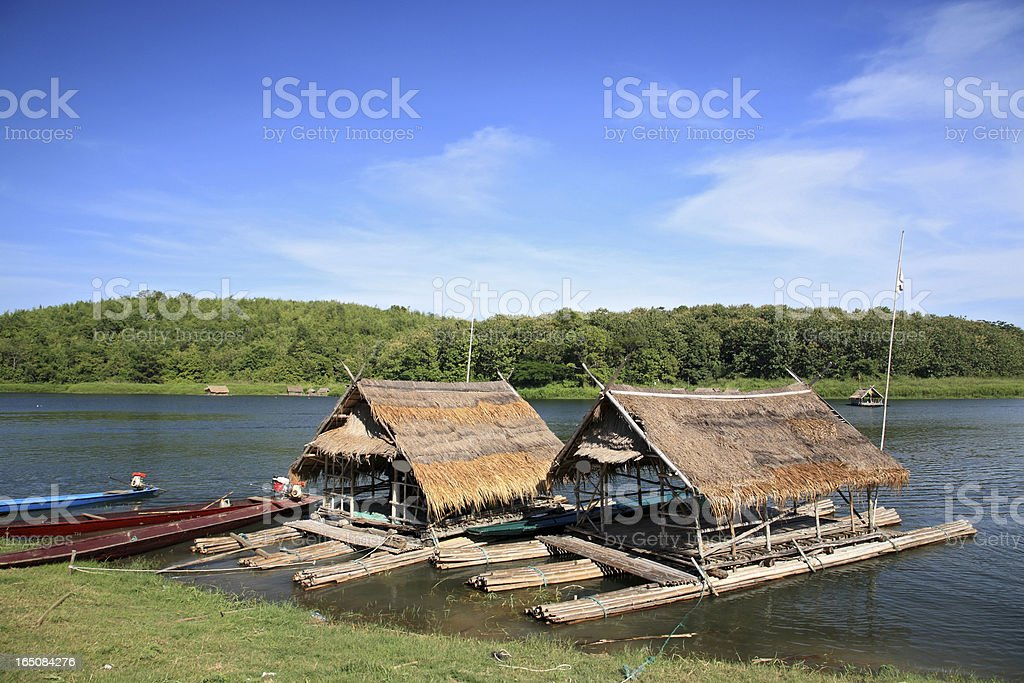 Two bamboo roof rafts floating on the lake royalty-free stock photo