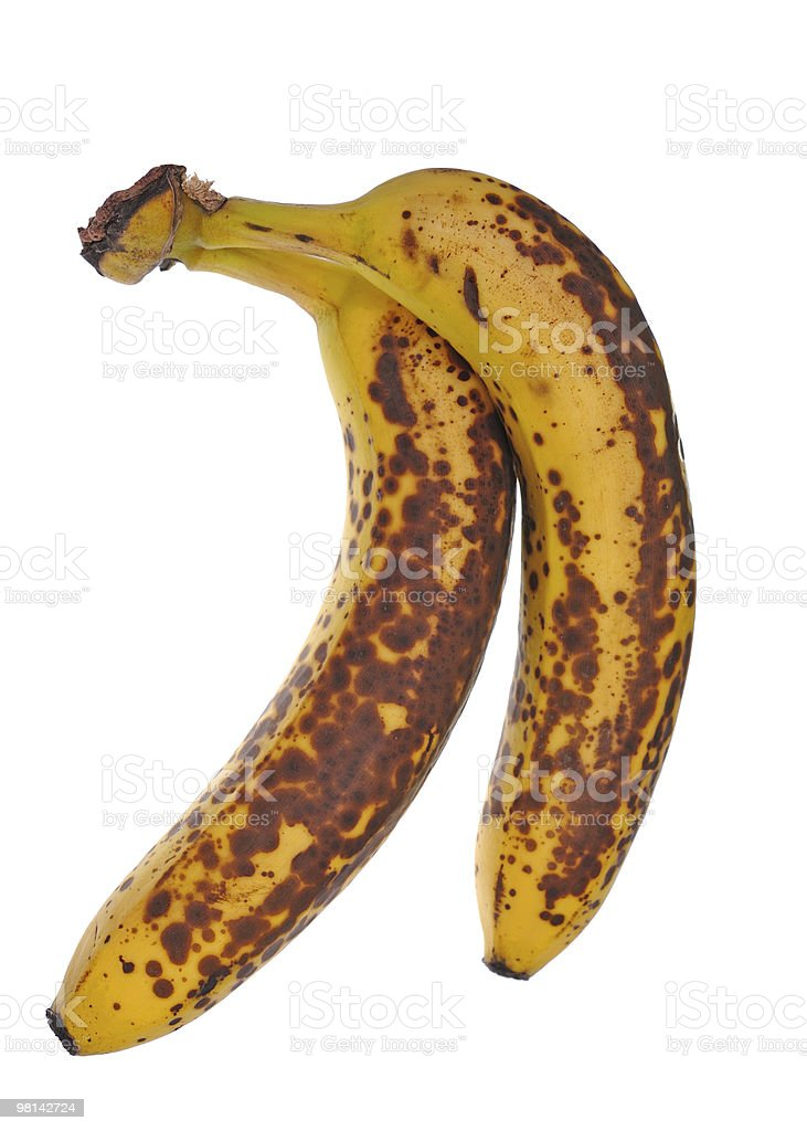 Two banana with a spotted peel royalty-free stock photo