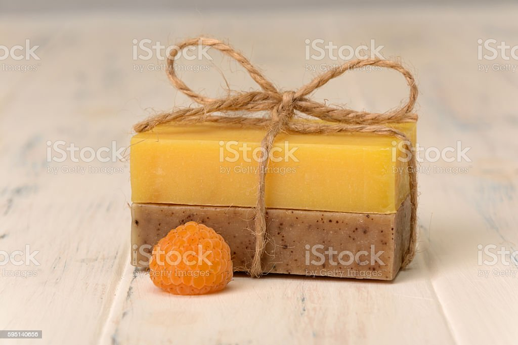 Two bar of soap and one berry raspberry stock photo