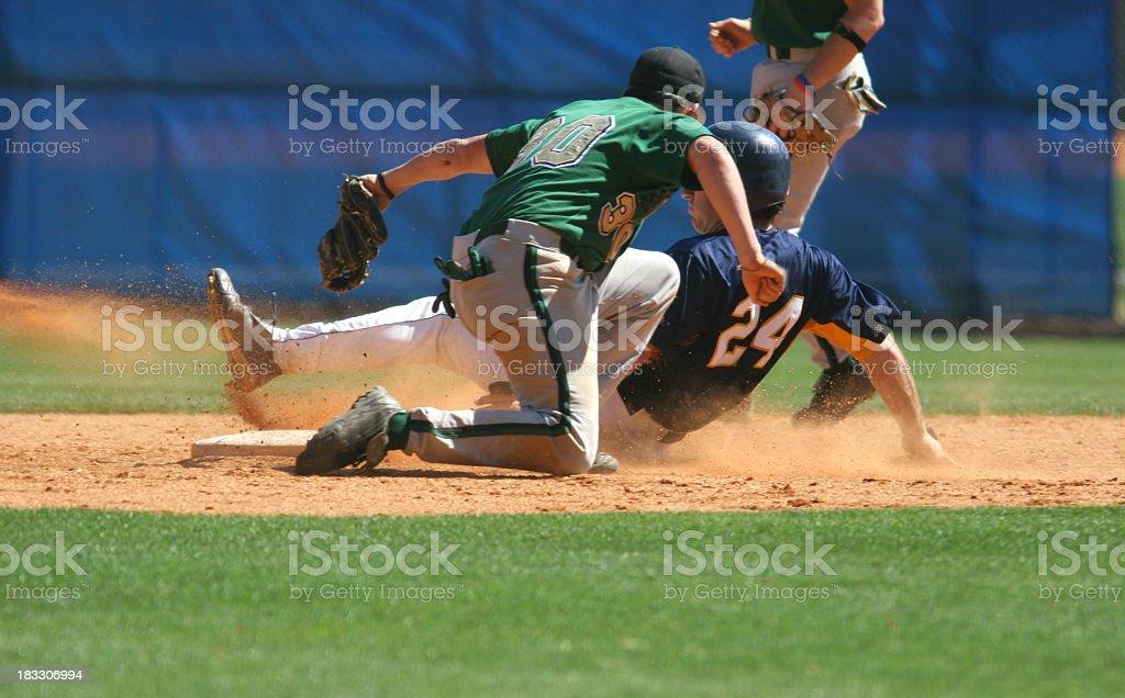 Two baseball players playing a game of baseball royalty-free stock photo