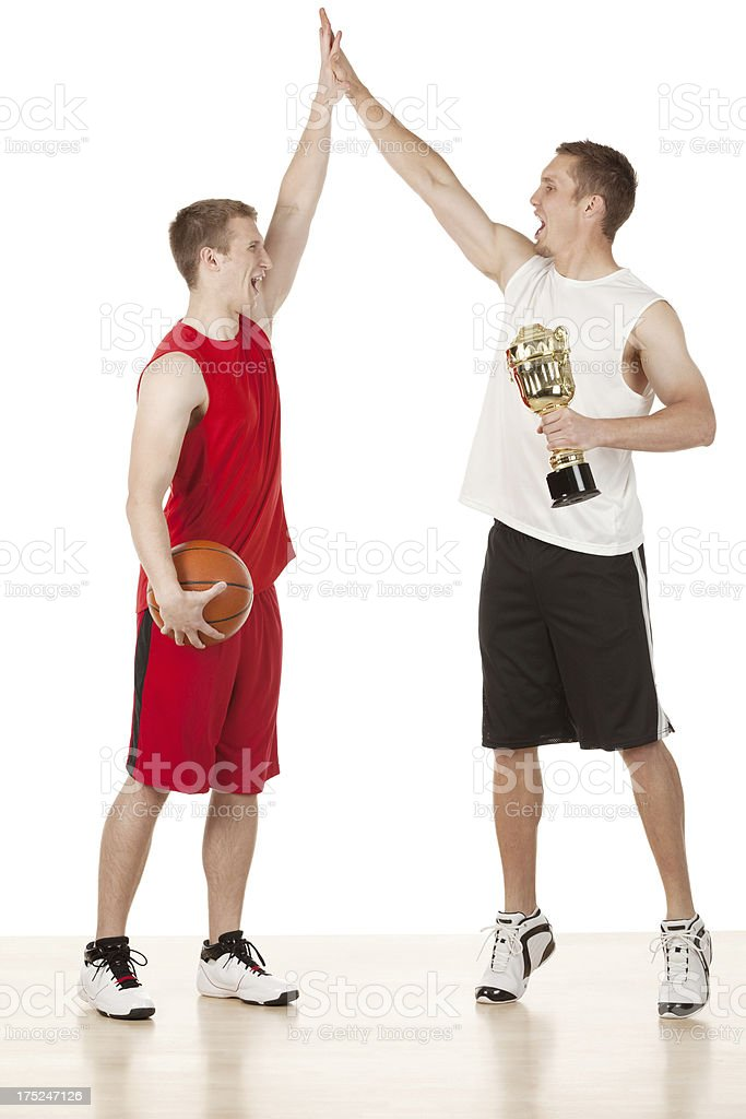 Two basketball players celebrating their success royalty-free stock photo