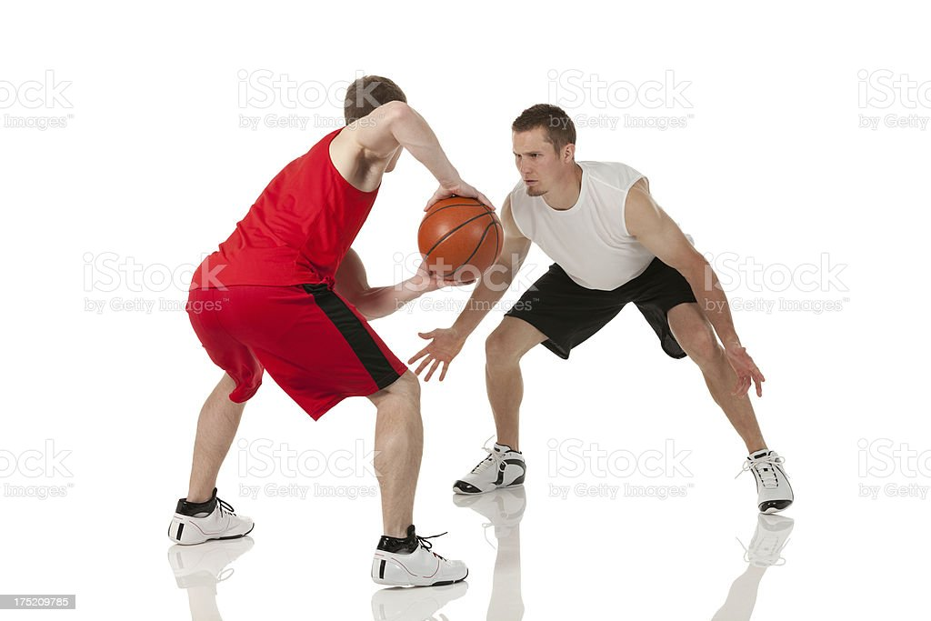 Two basketball players in action royalty-free stock photo