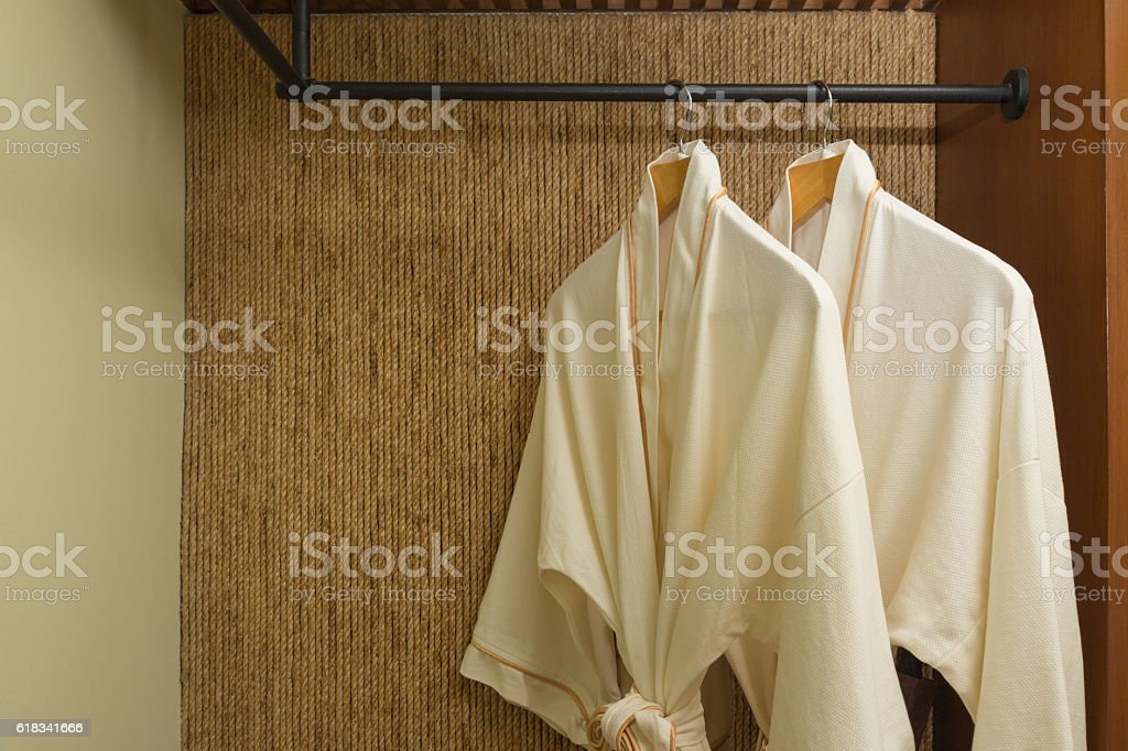 two bathrobes hanging in warmly design closet stock photo