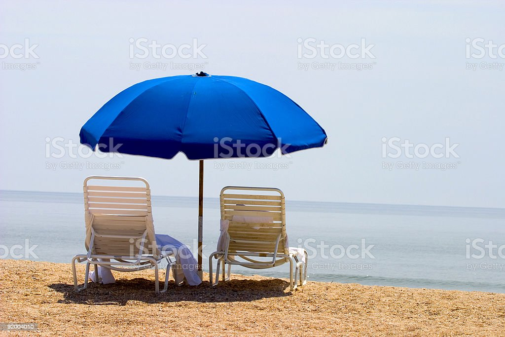 Two beach chairs and umbrella stock photo