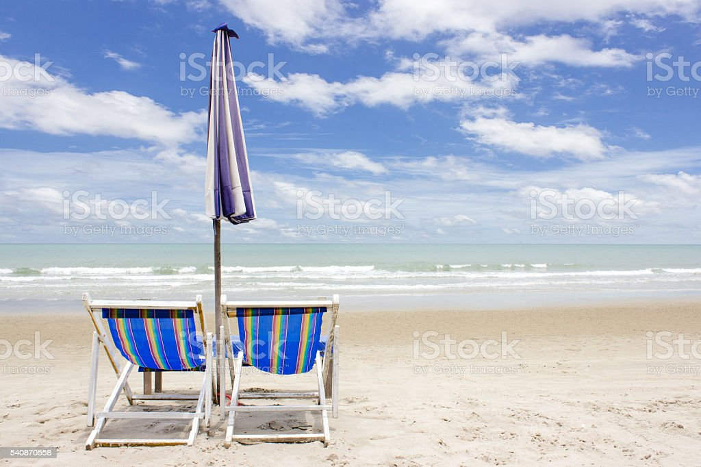 two beach lounge chairs and tent on beach. rayong, Thailand stock photo