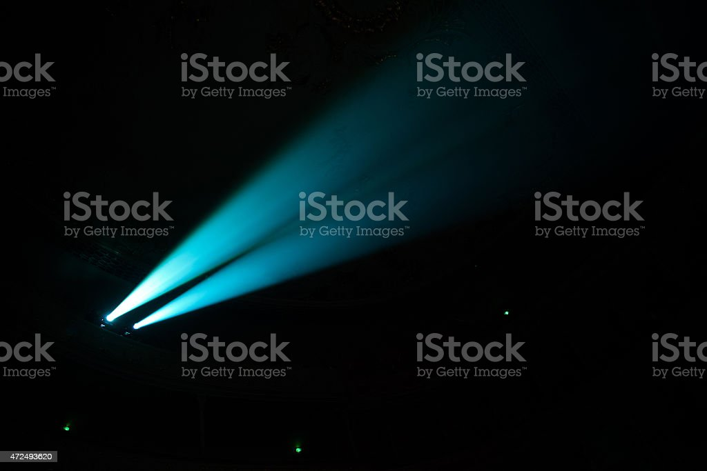 Two beams in dark concert hall. stock photo