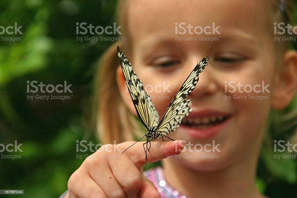 Two beauties -  Girl with butterfly on her finger stock photo
