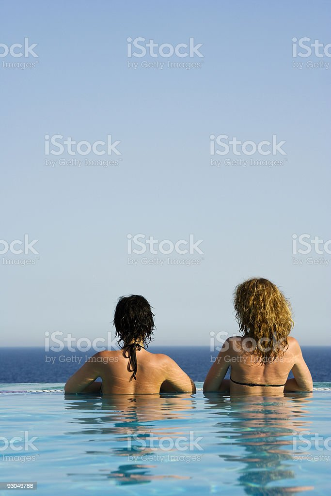 Two beauties in infinity pool royalty-free stock photo