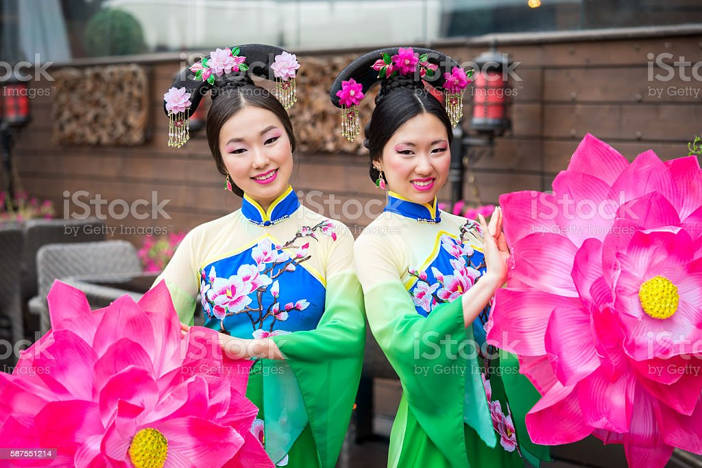 two beautiful asian girls in traditional chinese dresses stock photo