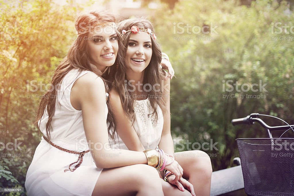 Two beautiful boho girl in the park stock photo