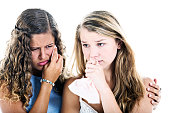 Two beautiful but weeping young women