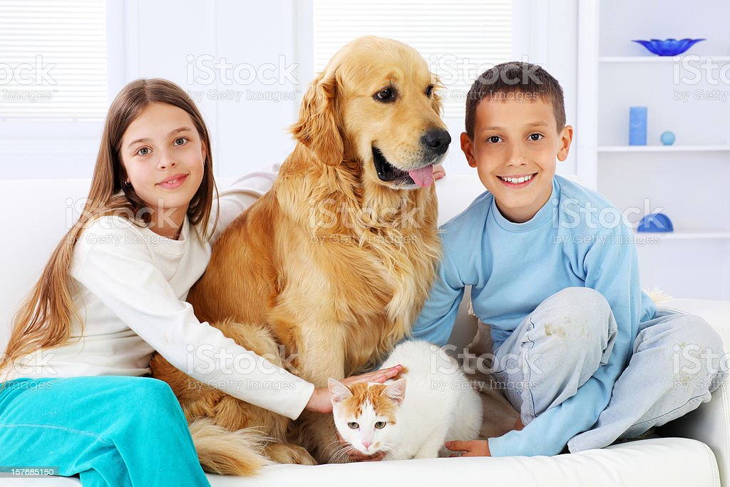 Two beautiful children enjoying with pets royalty-free stock photo