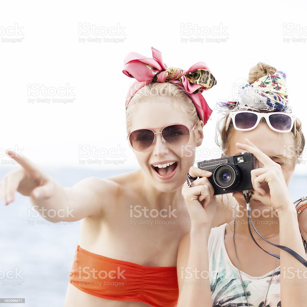 two beautiful girls at sea pier royalty-free stock photo