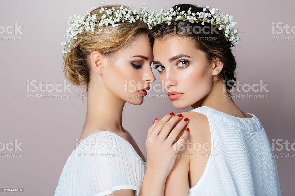Two beautiful girls at the studio stock photo