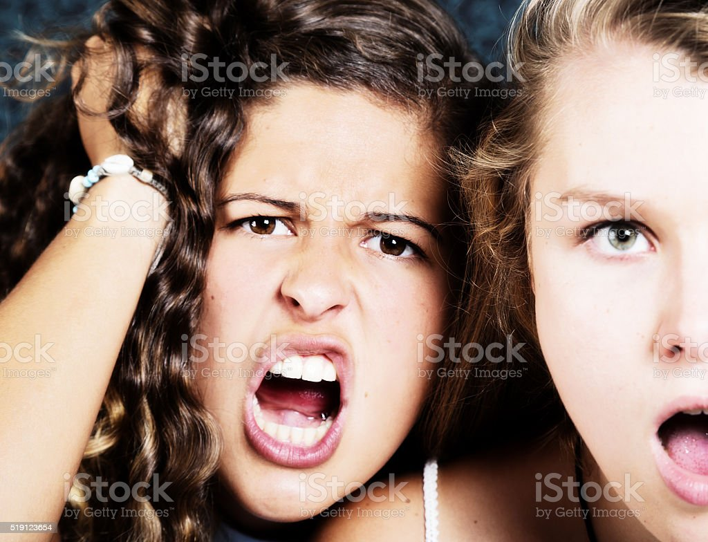 Two beautiful girls gasp in outraged shock stock photo