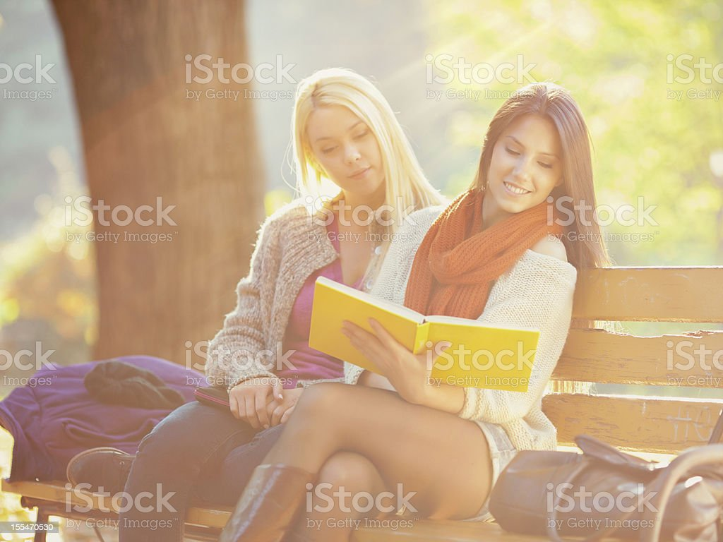 Two beautiful girls reading book royalty-free stock photo
